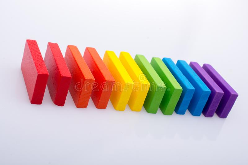 Coorful domino blocks on white background. Colorful Domino Blocks in a line on a white background royalty free stock photos