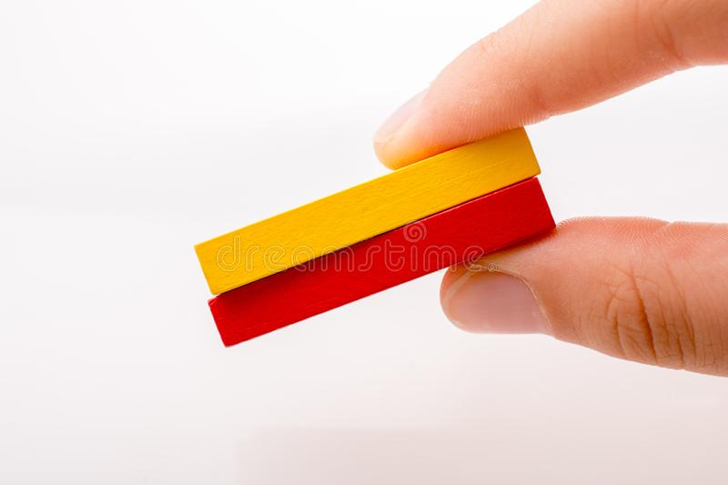 Coorful domino blocks on white background. Colorful Domino Blocks in a line on a white background royalty free stock photo