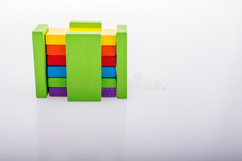 Coorful domino blocks on white background. Colorful Domino Blocks in a line on a white background royalty free stock photography