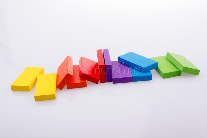 Coorful domino blocks on white background. Colorful Domino Blocks in a line on a white background royalty free stock images