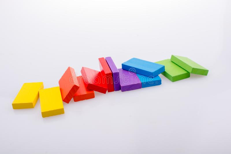 Coorful domino blocks on white background. Colorful Domino Blocks in a line on a white background stock photos