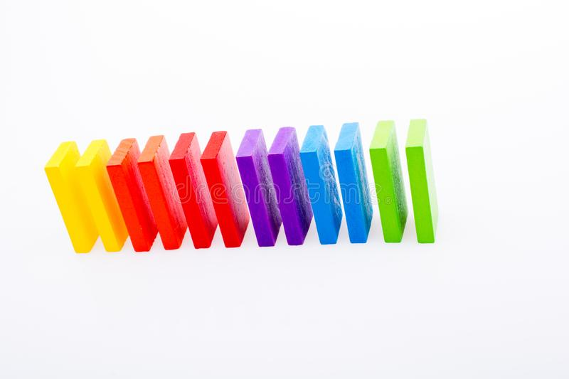 Coorful domino blocks on white background. Colorful Domino Blocks in a line on a white background royalty free stock image