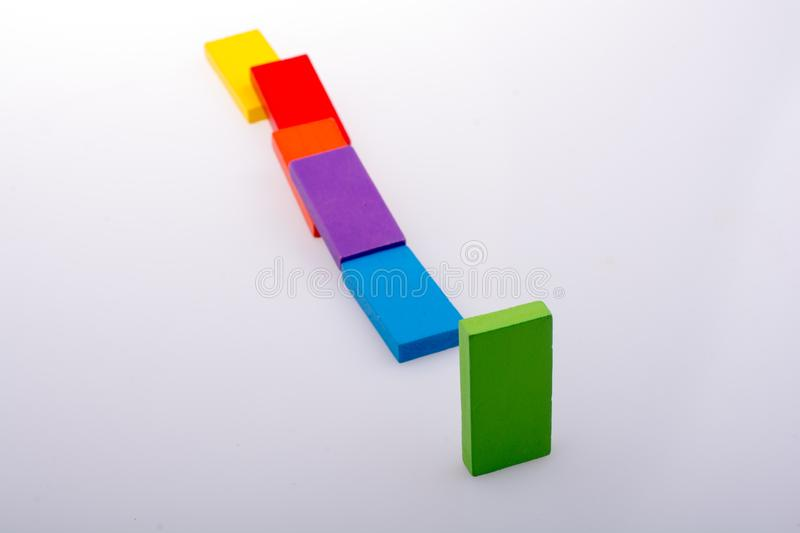 Coorful domino blocks on white background. Colorful Domino Blocks in a line on a white background stock images