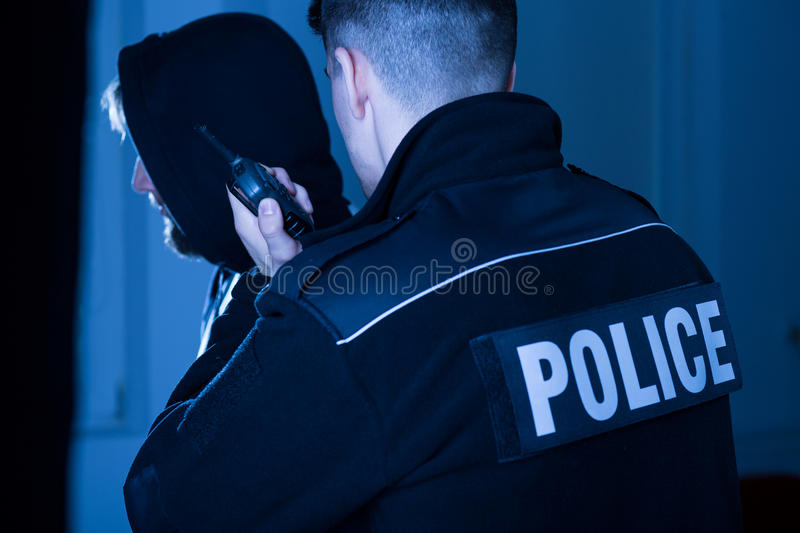 Cop informing police commandant. Image of an athletic cop informing police commandant about situation stock photos