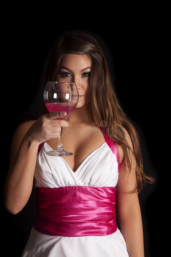 Copa de vino formal de la mujer por la cara imagenes de archivo