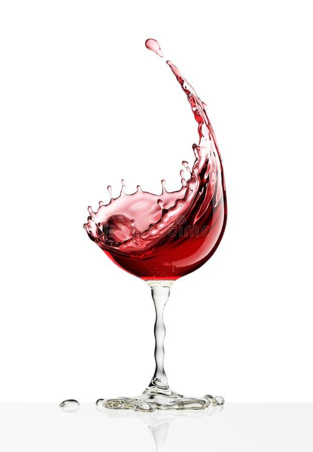 Copa de vino roja en un fondo blanco imagen de archivo libre de regalías