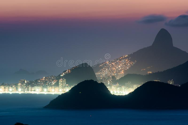 Copacabana Beach and Mountains at Night stock photo