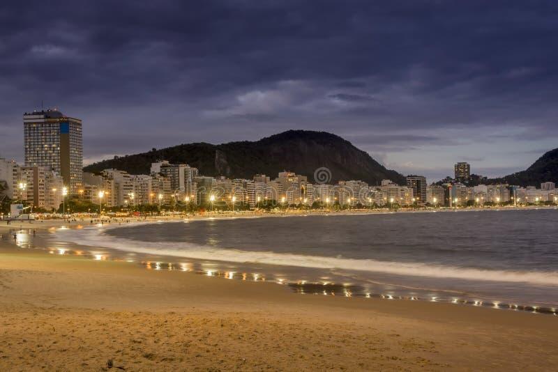 Copacabana beach at sunset, Rio de Janeiro, Brasil, Praia Copacabana landscape , Cityscape at dusk stock images