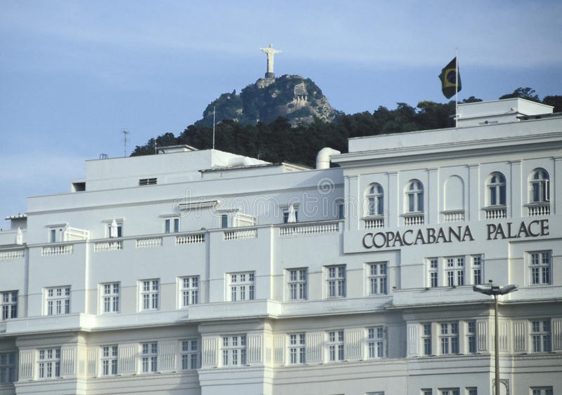 The Copacabana Palace hotel with the statue of Christ the Redeem royalty free stock image