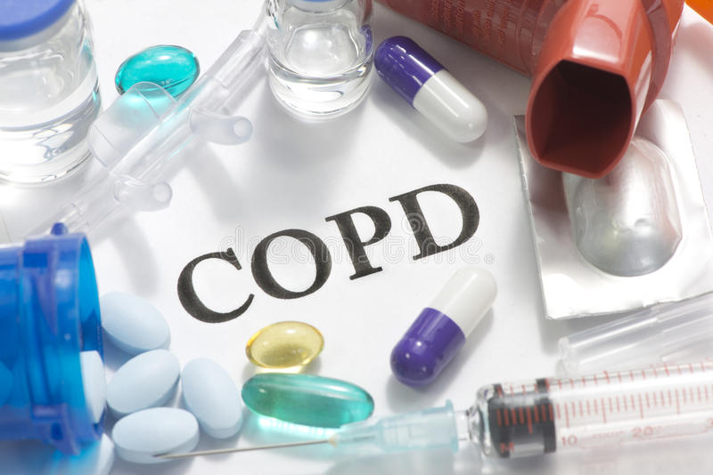 COPD. Concept photo with nasal cannula, pills, vials, and syringe stock photo