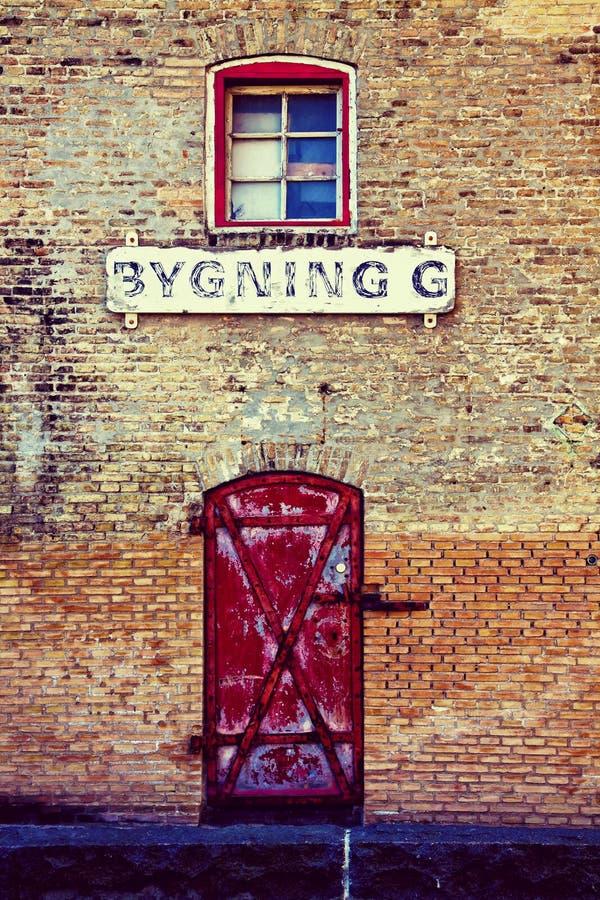 Copenhaga, Dinamarca - armazém antigo do tijolo fotografia de stock