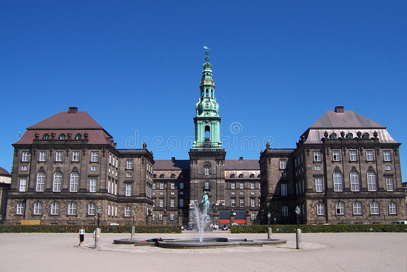 Copenhagen. A famous Copenhagen (Kopenhavn, Kopenhagen) building, well known touristic destination. It is called Christianborg Slot. Clear blue sky. Some people