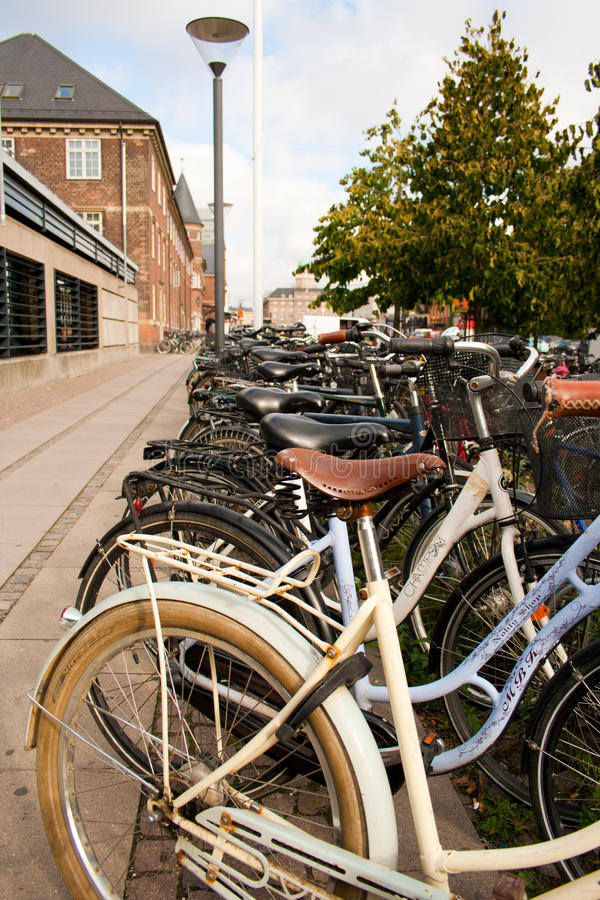 Copenhagen Bike Rack II. Denmark has a strong culture of cycling to work or to a place to take public transport. Most train stations have hundreds of bikes stock images