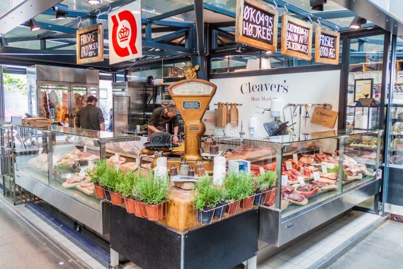 COPENHAGEN, DENMARK - AUGUST 28, 2016: Butcher stall inTorvehallerne indoor food market in the centre of Copenhage. N royalty free stock images