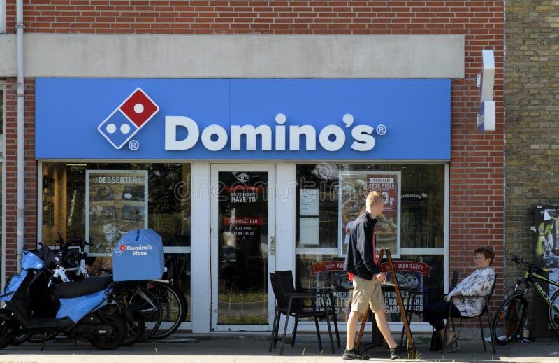 Domino`s pizza restaurant stock images