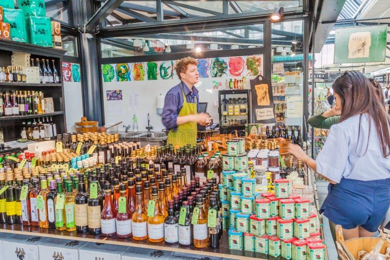 COPENHAGEN, DENMARK - AUGUST 28, 2016: People shop at a stall inTorvehallerne indoor food market in the centre of. Copenhagen stock photo
