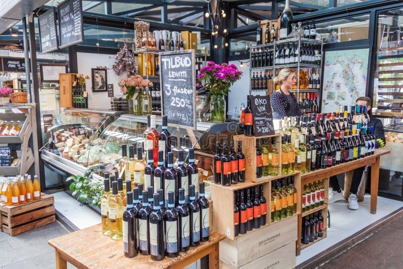 COPENHAGEN, DENMARK - AUGUST 28, 2016: Wine and cheese stall inTorvehallerne indoor food market in the centre of. Copenhagen stock photo
