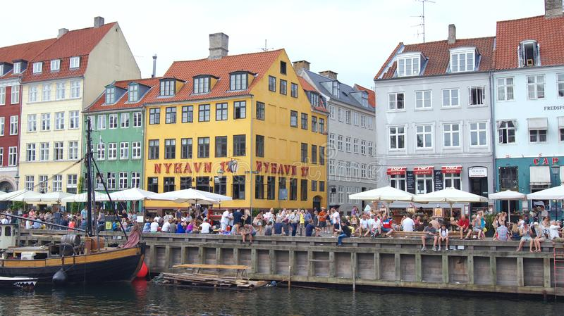 COPENHAGEN, DENMARK - JUL 04th, 2015: Nyhavn district is one of the most famous landmark in Copenhagen during a summer. Day stock photography