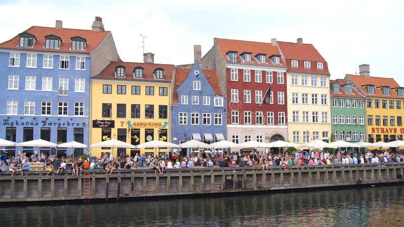 COPENHAGEN, DENMARK - JUL 04th, 2015: Nyhavn district is one of the most famous landmark in Copenhagen during a summer. Day stock photo