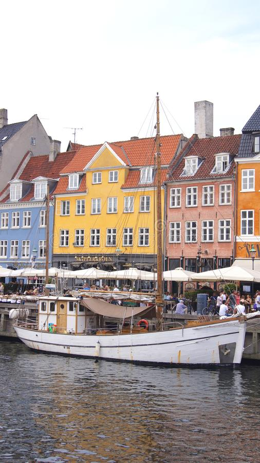 COPENHAGEN, DENMARK - JUL 04th, 2015: Nyhavn district is one of the most famous landmark in Copenhagen during a summer. Day royalty free stock photo