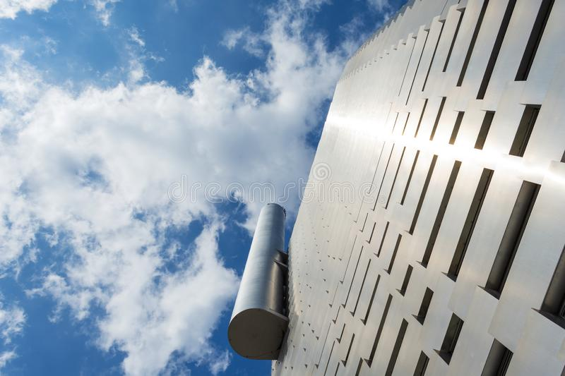 Copenhagen. Denmark. 23 July. 2019.Facade of a modern metal building against a cloudy sky. Bottom view Architecture. Background.Power station in the city of stock images