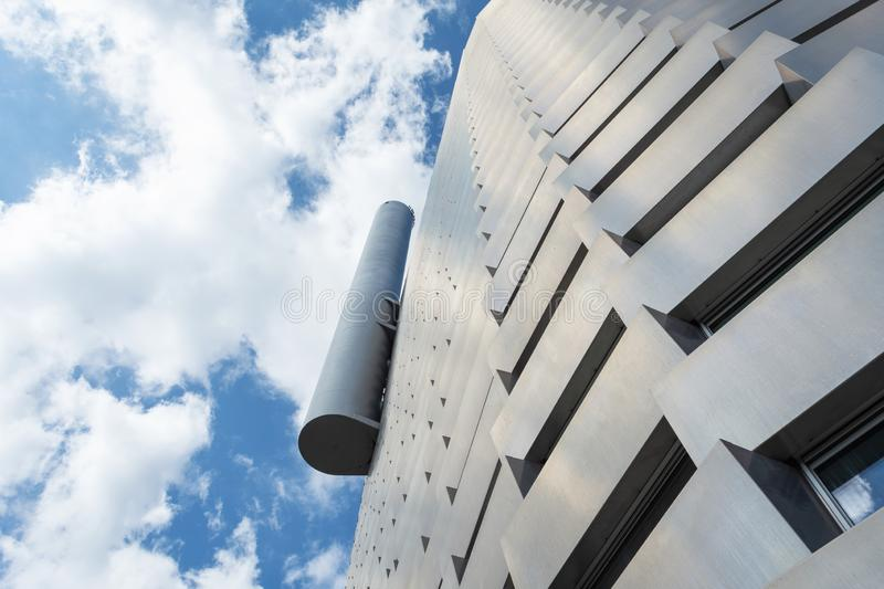 Copenhagen. Denmark. July 23th. 2019: Facade of a modern metal building against a cloudy sky. Bottom view Architecture. Background.Power station in the city of royalty free stock photography