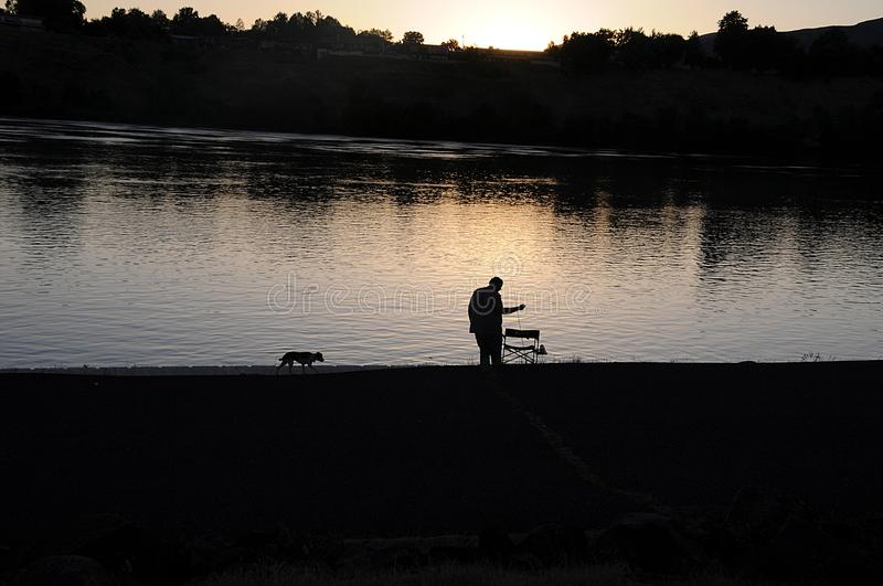 PEOPLE FISHING IN SNAKE RIVER . royalty free stock photo