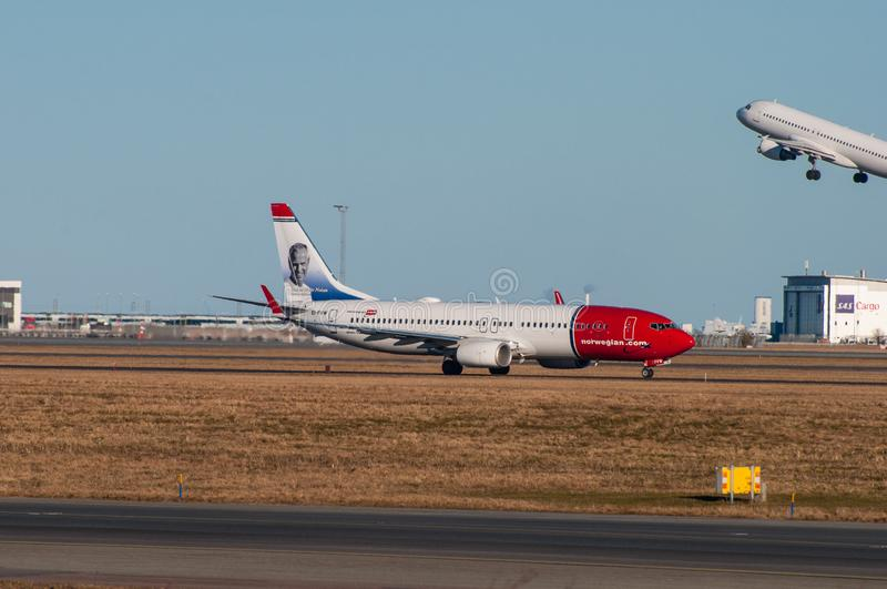 Norwegian Boeing 737-800 airplane in Copenhagen airport royalty free stock image
