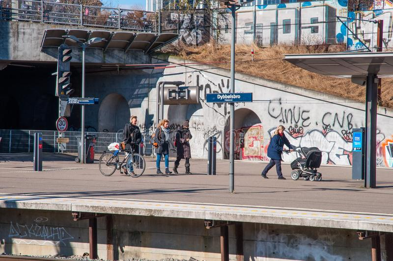 Passengers waiting for the train at Dybbolsbro local train station stock image