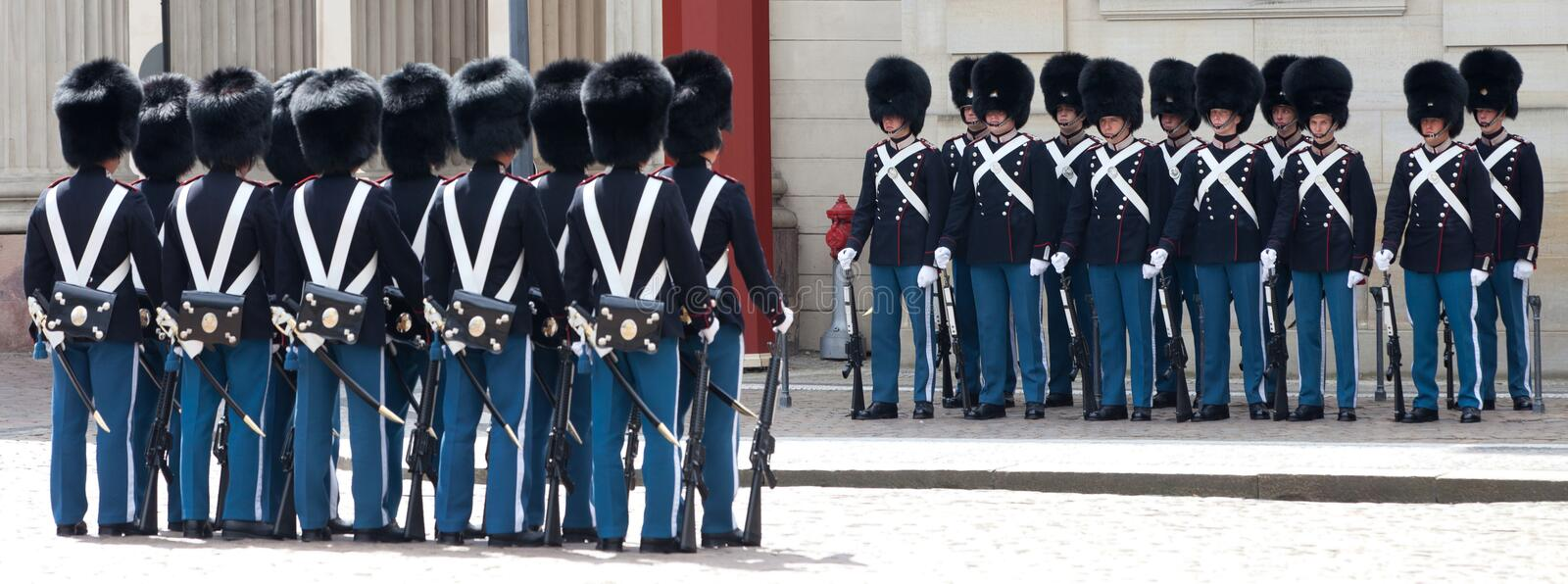 COPENHAGEN, DENMARK - MAY 17, 2012: Ð¡hanging of the honor guard at the Royal Palace Amalienborg in Copenhagen stock photography