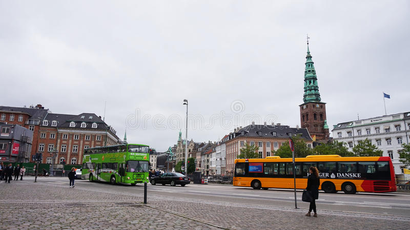 COPENHAGEN, DENMARK - MAY 31, 2017: View of Vindebrogade street and Christiansborg square with the Saint Nikolas church bells towe. R, Copenhagen, Denmark stock image