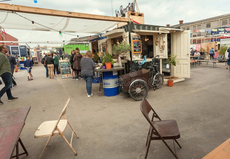 People ordering food at kiosk of Reffen, street food market in urban area for start-ups royalty free stock photo