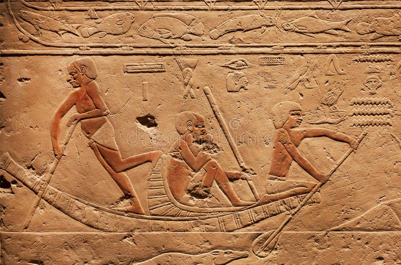 People on riverboat, relief on ancient Tomb of Sakkara, made at 2300 BC in Egypt, saved by Carlsberg Glyptotek royalty free stock image