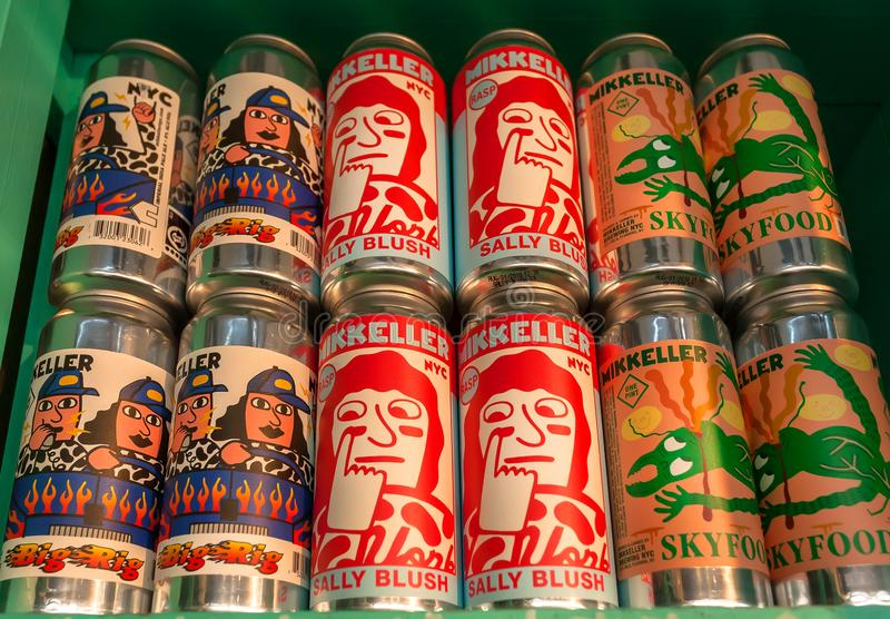 Popilar danish beer by Mikkeller brewery with bright comic design of cans of drinks royalty free stock image