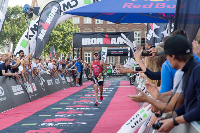 Copenhagen Ironman 2016, Denmark. Copenhagen, Denmark - August 21, 2016: Triathlete Fabio Carvalho just before crossing the finish line as 3rd in men's in 08:07 stock photography