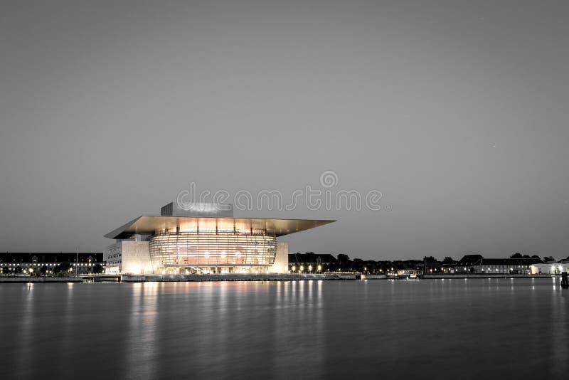 Copenhagen Opera House black and white. Copenhagen, Denmark - June 05, 2016: The illuminated Opera House designed by Henning Larsen architects in black and white stock images