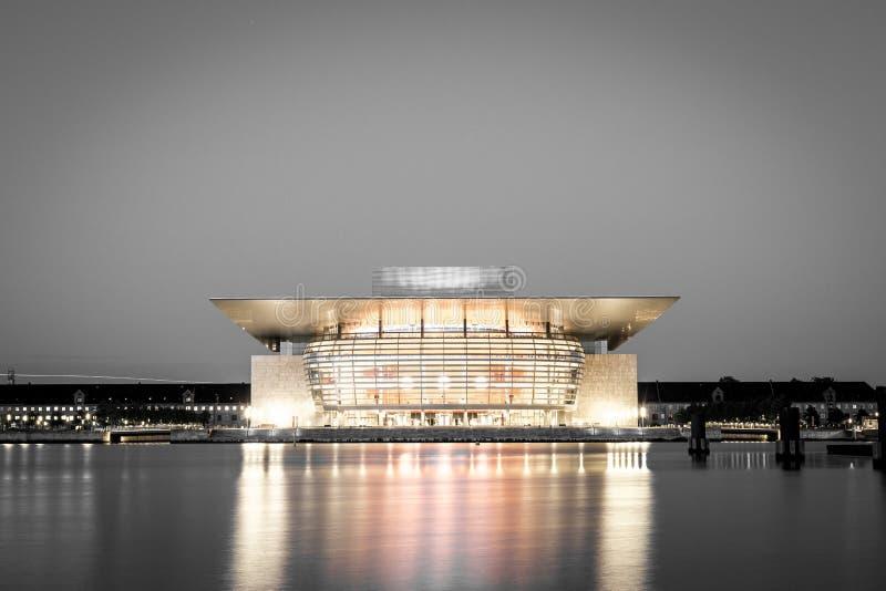 Copenhagen Opera House black and white. Copenhagen, Denmark - June 05, 2016: The illuminated Opera House designed by Henning Larsen architects in black and white royalty free stock photo