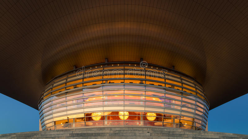 Copenhagen Opera House by night. Copenhagen, Denmark - July 28, 2016: The illuminated Opera House designed by Henning Larsen architects by night royalty free stock photos
