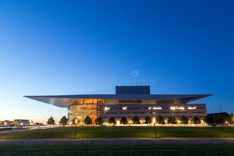 Copenhagen Opera House by night. Copenhagen, Denmark - July 28, 2016: The illuminated Opera House designed by Henning Larsen architects by night stock photo