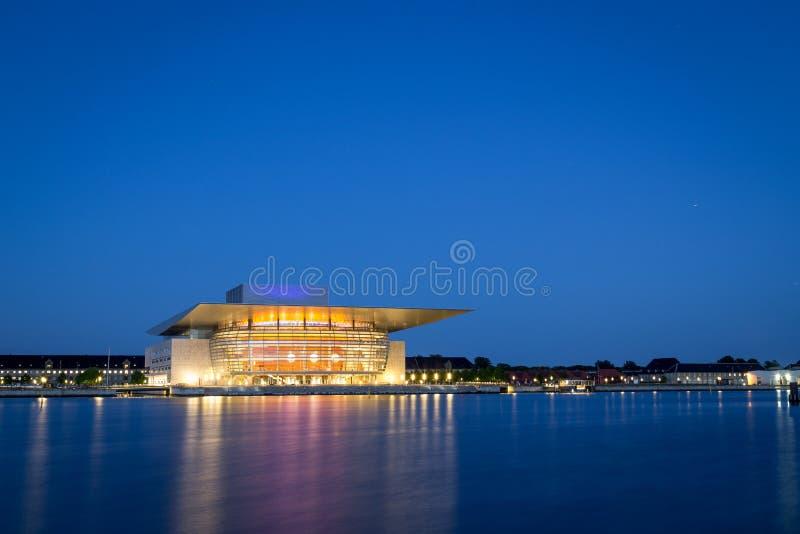 Copenhagen Opera House by night. Copenhagen, Denmark - June 05, 2016: The illuminated Opera House designed by Henning Larsen architects by night stock image