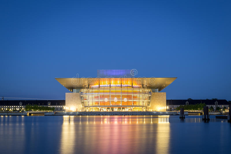 Copenhagen Opera House by night. Copenhagen, Denmark - June 05, 2016: The illuminated Opera House designed by Henning Larsen architects by night stock photo