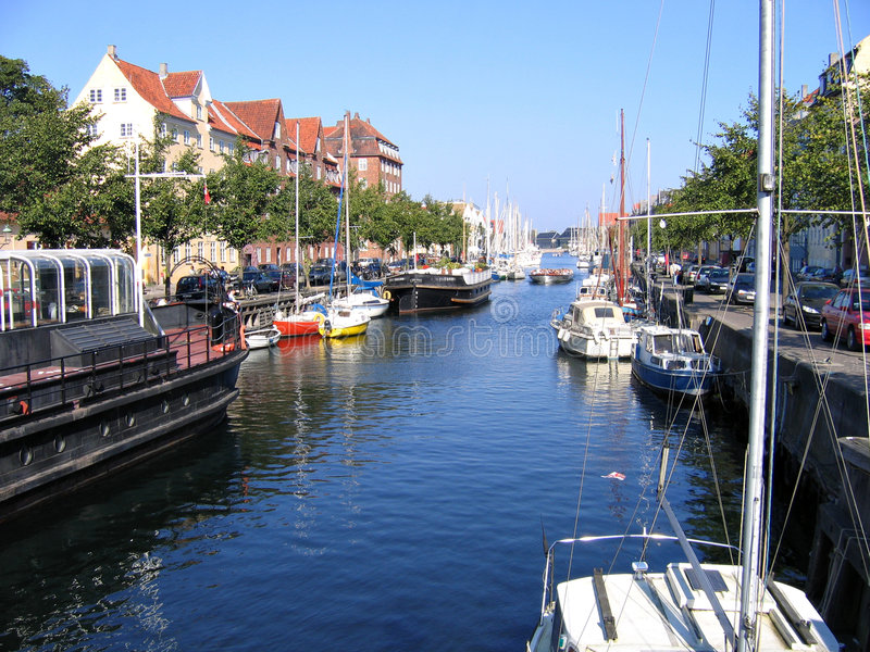 Copenhagen - water front houses and boats. Copenhagen - houses and boats in the water front of the water canals royalty free stock photos