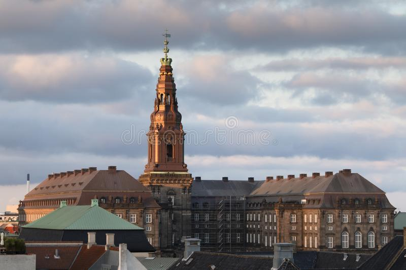 Copenhagen, Zealand Denmark - June 27 2019: Christiansborg Palace building at sunset from orher rooftop. At cloudy day stock photography