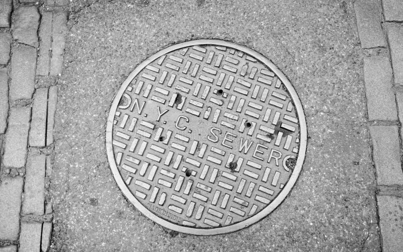 Coperchio di botola di New York City fotografie stock libere da diritti