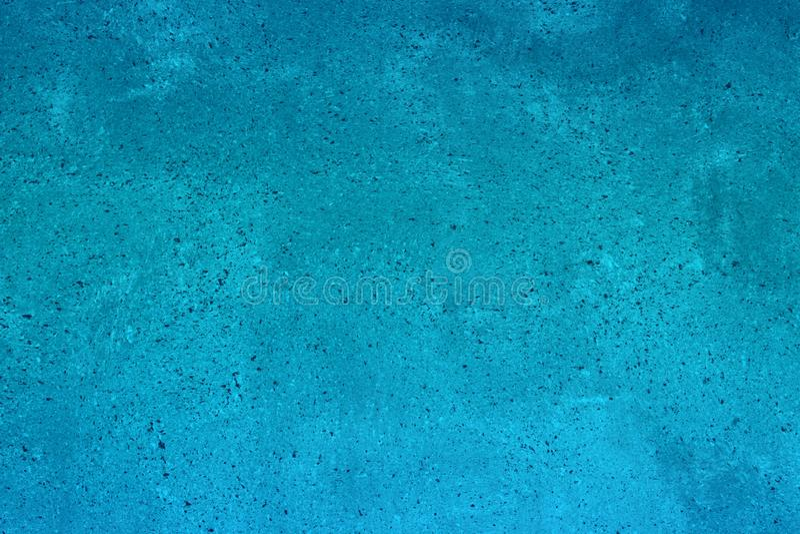 Copertura approssimativa punteggiata blu-chiaro sulla struttura del pavimento - fondo abbastanza astratto della foto fotografia stock libera da diritti
