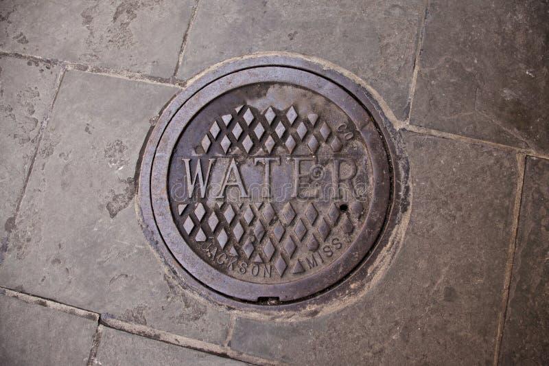 Copertura di botola dell'acqua a New Orleans immagini stock