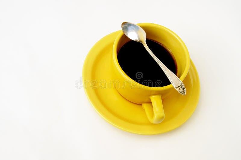 Copo amarelo do chá fotografia de stock