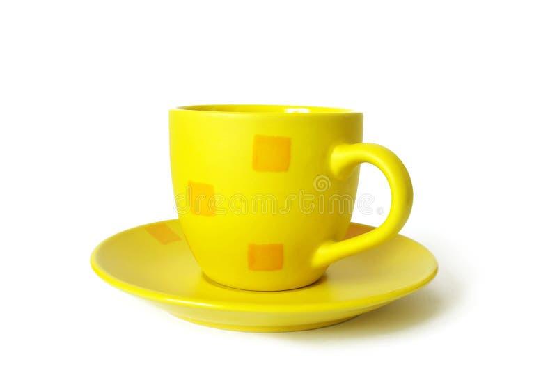 Copo cerâmico amarelo foto de stock