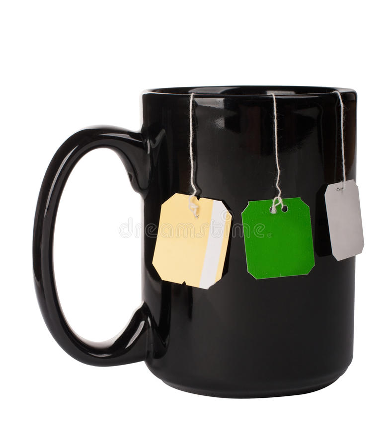 Copo com os três sacos de chá foto de stock