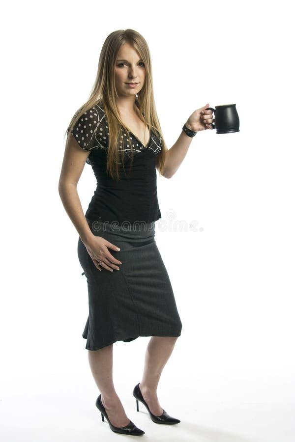 Copo da terra arrendada da mulher fotos de stock